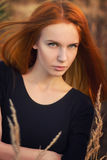 Serious woman. With red hair portrait Stock Images