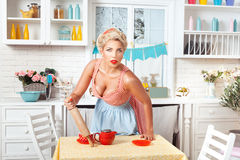 Serious woman with a rolling pin. Stock Photos