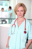 Serious woman in scrubs Royalty Free Stock Image