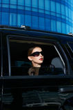 Serious Woman in Shades Inside Expensive Car Stock Photo
