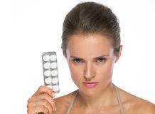 Serious woman showing blistering package of pills Royalty Free Stock Image