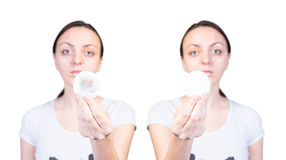Serious Woman Showing Clean and Dirty Cotton Balls Royalty Free Stock Image