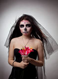 Serious woman in skull face art mask and flowers Royalty Free Stock Photography