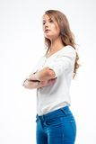 Serious woman standing with arms folded Royalty Free Stock Image