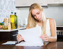 Serious woman staring financial documents Stock Images