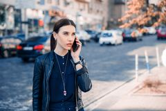 Serious woman talking on Mobile in the City stock photo