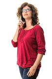 Serious woman talking at smartphone Royalty Free Stock Photography