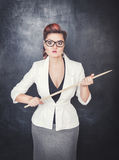 Serious woman teacher pointing out on blackboard background. Serious woman teacher pointing out on chalkboard blackboard background Stock Photography
