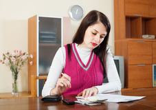 Serious woman thinking about the financial problems Royalty Free Stock Photo