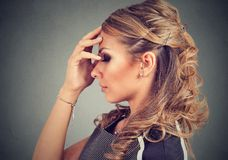 Serious young woman thinking very hard. Serious woman thinking very hard Stock Images