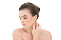 Serious woman touching her neck Royalty Free Stock Photography