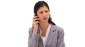 Serious woman using her mobile phone Royalty Free Stock Images