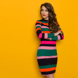 Serious Woman In Vibrant Striped Dress Is Looking Away Stock Images