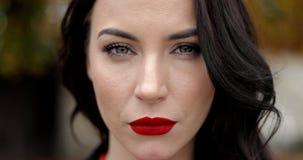 Serious woman with vivid makeup stock video