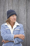 Serious woman warm bonnet and jacket outdoor Royalty Free Stock Photography