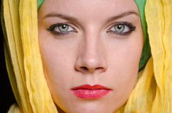 Serious woman wearing colourful headscarf Stock Photo