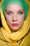 Serious woman wearing colourful headscarf Royalty Free Stock Photo