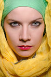 Serious woman wearing colourful headscarf Royalty Free Stock Images