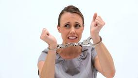 Serious woman wearing handcuffs