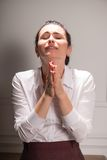 Serious woman wearing white blouse Stock Photography