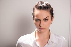 Serious woman wearing white blouse Stock Photo