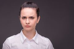 Serious woman wearing white blouse Stock Image