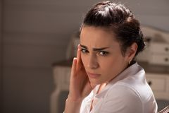 Serious woman wearing white blouse Stock Images