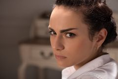 Serious woman wearing white blouse Royalty Free Stock Photography