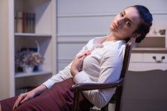Serious woman wearing white blouse Royalty Free Stock Image