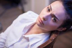 Serious woman wearing white blouse Royalty Free Stock Photo