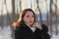Serious woman in winter park. People Royalty Free Stock Photography