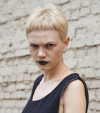 Serious woman witn black lipstick Stock Photo