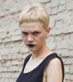 Serious woman witn black lipstick Stock Photo
