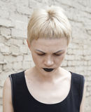 Serious woman witn black lipstick Stock Photography