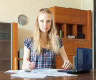 Serious  woman working with financial document Stock Image