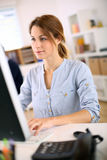 Serious woman working in office Royalty Free Stock Images