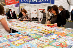 Serious women choose books at the indoor book market Royalty Free Stock Images