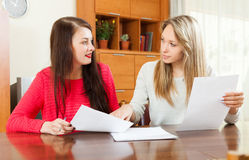 Serious women looking financial documents Stock Images