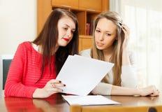 Serious women reading documents Stock Photo
