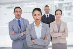 Serious work team posing crossing arms Stock Photos