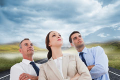 Serious work team posing together looking away Royalty Free Stock Photos