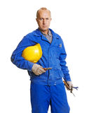 Serious worker holding his hardhat Royalty Free Stock Images