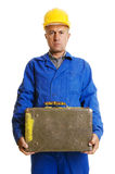 Serious worker with old suitcase Royalty Free Stock Photos