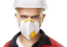 Serious worker wearing respirator Stock Photography