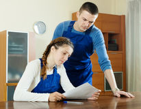 Serious workers in uniform with  documents Royalty Free Stock Image