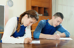 Serious workers in uniform filling in questionnaire Royalty Free Stock Photo