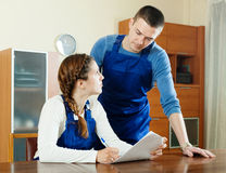 Serious  workers  in uniform filling in questionnaire Royalty Free Stock Image