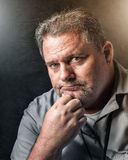 Serious working man. Portrait of a middle aged working man royalty free stock images