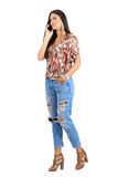 Serious worried young casual beauty talking on the phone Stock Images