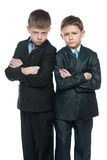 Serious yong boys on the white background Stock Photography
